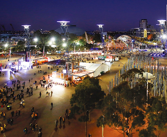 A photograph of people enjoying an event in Sydney Olympic Park.