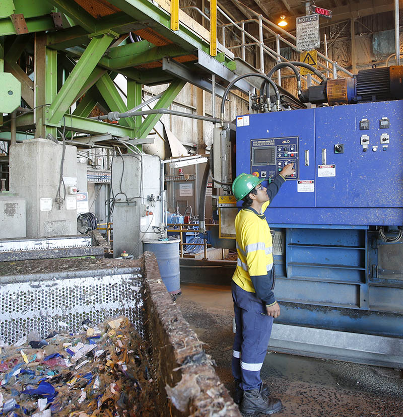 Photograph of man in a recycling plant