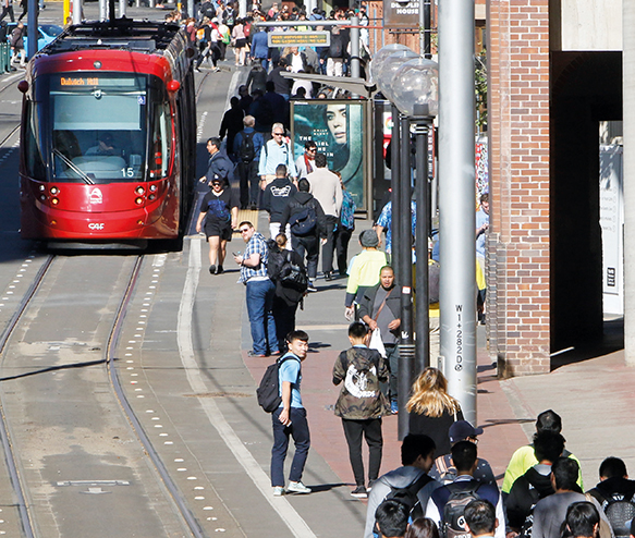 Photo of busy street and light rail