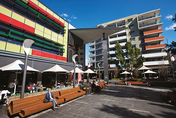 Photograph of people enjoying cafes and open-air seating in Rouse Hill Town Centre.