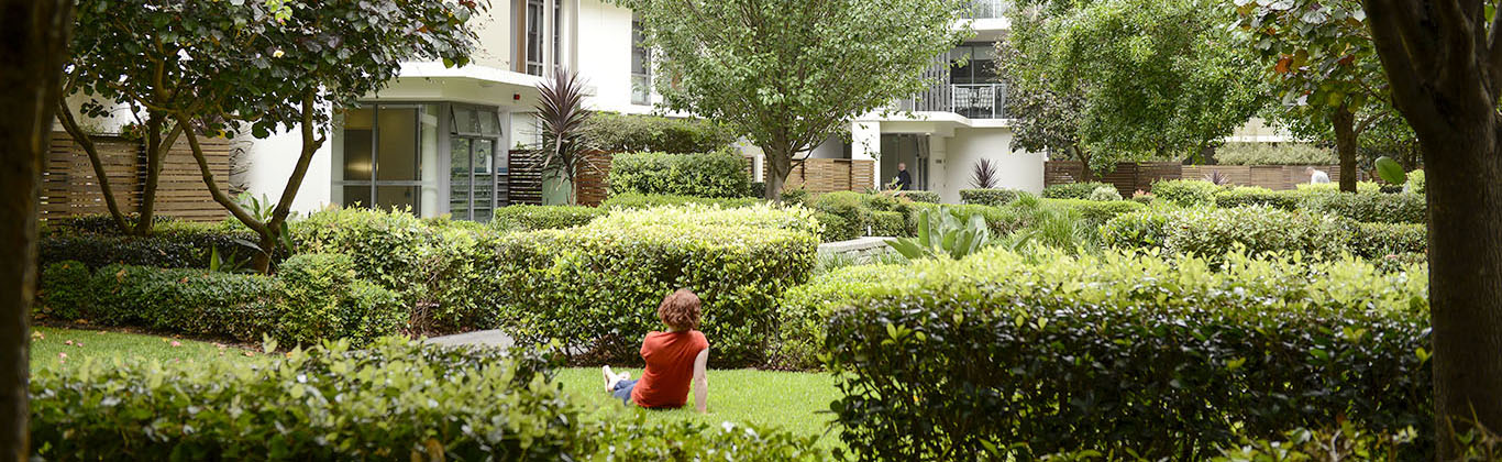 Photograph of a garden in an apartment building complex.