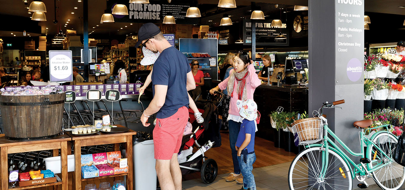 People shopping at Crows Nest About Life supermarket and wholefoods café in Willoughby Road.