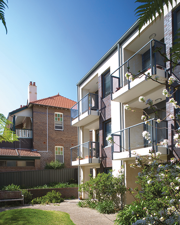 A photograph of modern alongside twentieth century apartments at Woolwich.