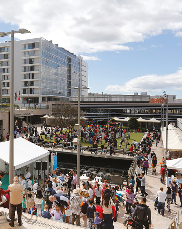 A crowd of people attending an outdoor event at The Concourse, Chatswood.