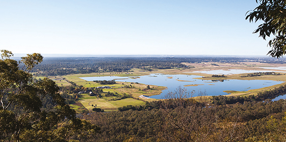 Photograph of lakes surrounded by greenery in Penrith Lakes